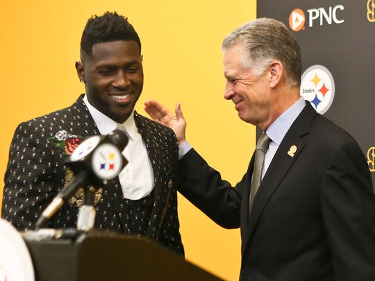 Pittsburgh Steelers wide receiver Antonio Brown, left, smiles as he is introduced by Steelers President Art Rooney II for a news conference about Brown's contract extension at the NFL football team's headquarters, Tuesday, Feb. 28, 2017, in Pittsburgh. (AP Photo/Keith Srakocic)