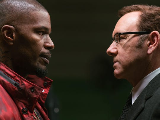 Master thief Bats (left, Jamie Foxx) and crime boss Doc (Kevin Spacey) have words in 'Baby Driver.'
