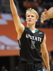 USC Upstate's Ty Greene calls for the crowd as they gain a lead against Tennessee during the first half at Thompson-Boling Arena in Knoxville, Saturday, Nov. 16, 2013.