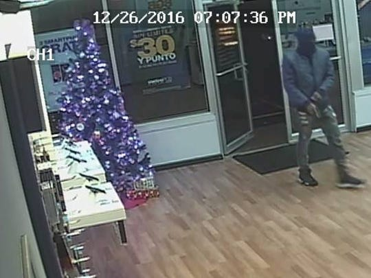 Evansville police have released photos of the suspect in a Metro PCS robbery on Monday night.