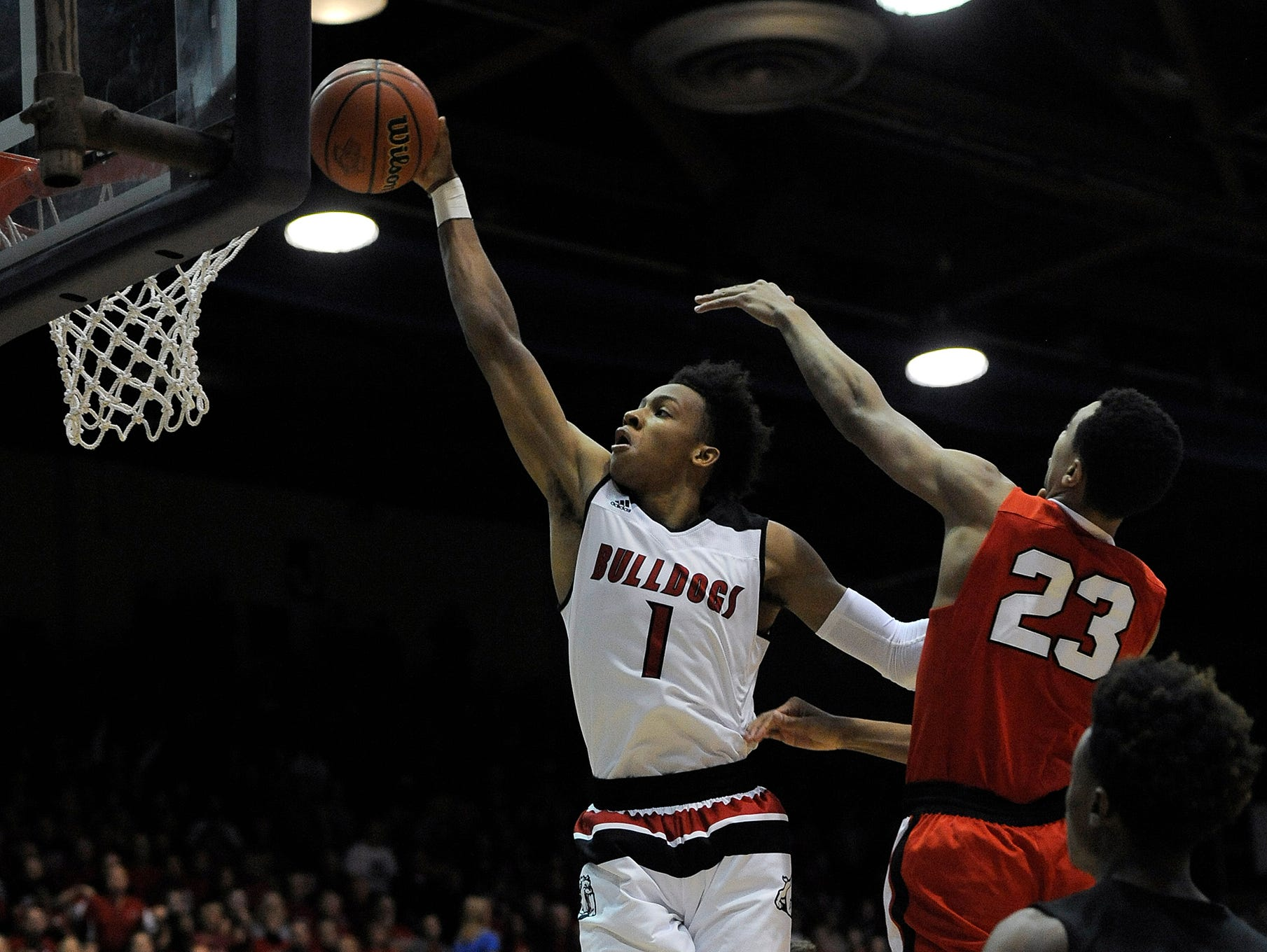 New Albany's Romeo Langford (1) dunks against Center Grove's Trayce Jackson-Davis (23) on Saturday in the first game of the 2017 IHSAA 4A Regional Basketball Tourney at Seymour High School. New Albany won 57-52. Mar. 11, 2017