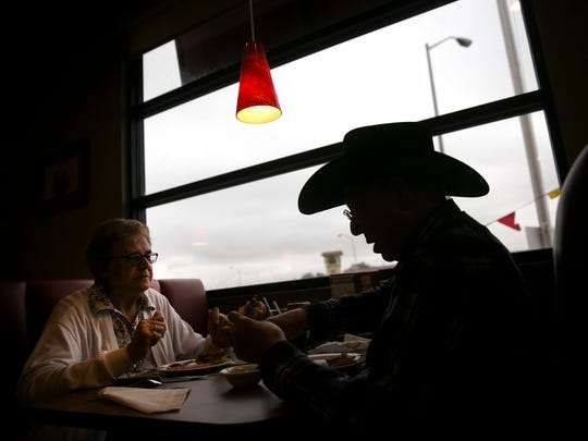 Rose Chromy and Jerry Judah eat lunch, Wednesday, Sept. 27, 2017 at Denny's in Farmington.