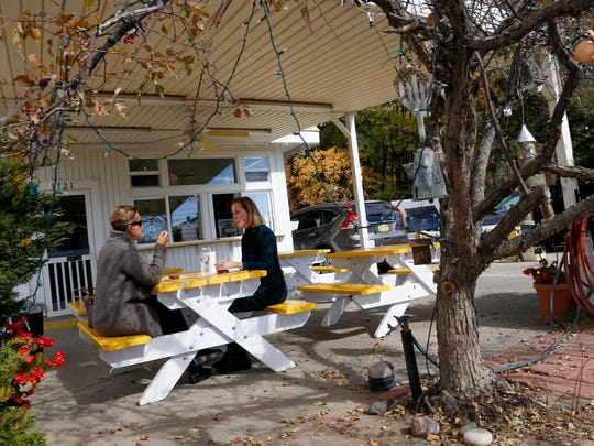 Susan Palko-Scharaa, left, and Becky Wilkins enjoy lunch Thursday at the Soup Station in Aztec.