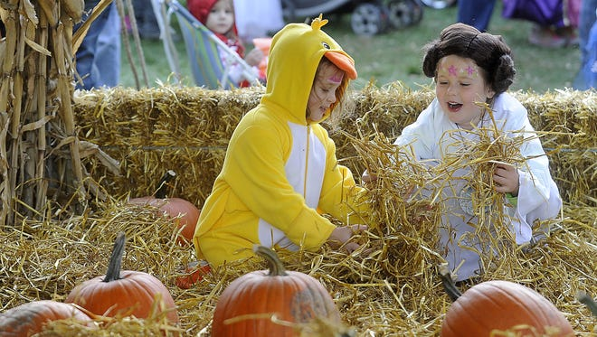 Sarah Johnson and Brooklyn Mair play during the Halloween Harvest Fest at YMCA Camp Leif Ericson in Sioux Falls, SD; Saturday, Oct. 17, 2015.