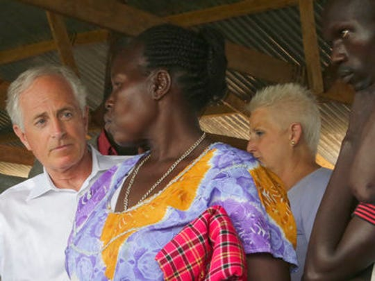 Senator Bob Corker, left, speaks with a woman who has