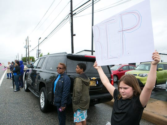 Gracie Riccio, 8, of New Castle, holds up a rest in