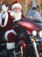 Santa rides a cycle in the Hendersonville Christmas parade on Dec. 3.