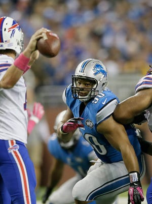 Detroit Lions' defensive tackle Ndamukong Suh (90 center) rushes Buffalo Bills' quarterback Kyle Orton in the Bills' 17-14 win Oct. 5. Suh had three solo tackles.