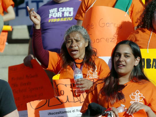 Lorena Valejo of California, center, cheers during