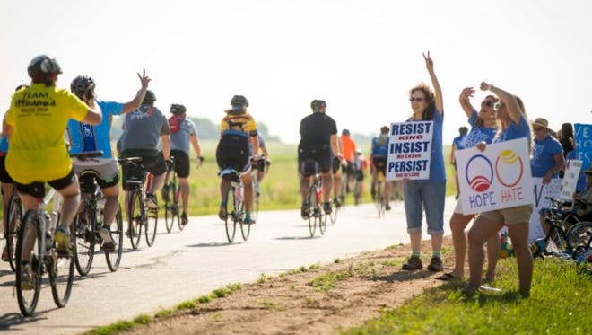A small protest against U.S. Rep. Steve King, R-IA, greeted riders on the second day of RAGBRAI 2017 on their way to the overnight town of Algona