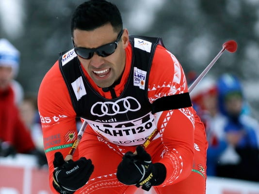 "FILE - In this Feb. 23, 2017 file photo, Tonga's Pita Taufatofua competes in the men's cross country sprint qualification at the 2017 Nordic Skiing World Championships in Lahti, Finland. Taufatofua joked that he has two primary goals when he competes in his first Olympic event on Friday, Feb. 16, 2018, don't hit a tree and finish before they turn the lights off. The medal podium is far from the mind of the ""shirtless"" Tongan, who qualified for the event despite having spent less than 12 weeks of his life on snow. He said his long-term goal at the Pyeongchang Games is to inspire others from the South Pacific to give the Olympics a shot.  (AP Photo/Matthias Schrader, File)"
