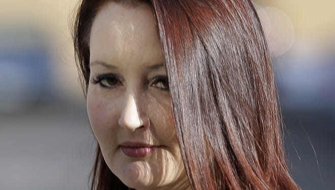 Gypsy Willis, the 37-year-old mistress of Martin MacNeill, arrives at court Friday in Provo, Utah. Willis is scheduled to take a much-anticipated turn on the witness stand. Prosecutors are trying to prove that MacNeill plotted his wife's 2007 death while carrying on an affair with the aspiring nursing student.
