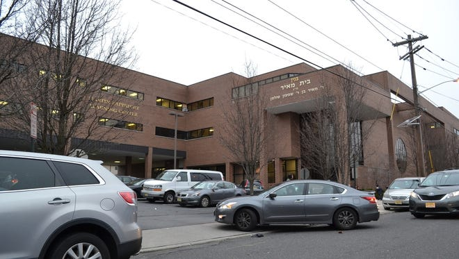 Clifton zoning commissioners ruled in favor of a Passaic yeshiva for boys Wednesday night, granting its request that the board rehear months of testimony due to a conflict of interest involving an engineering consultant retained by the city.