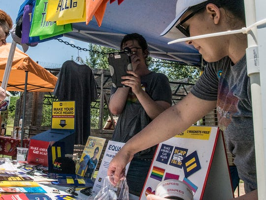 Guests at the Human Rights Campaign booth. Montgomery Pride capped off a week of activities Sunday, June 24, 2018, with the Montgomery Pride Festival at EAT South downtown farm.