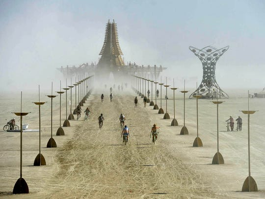 Burning Man 2017Burner ride their bikes toward the