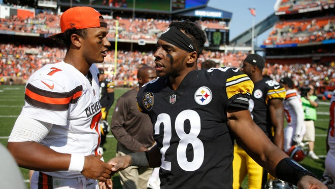 Cleveland Browns quarterback DeShone Kizer (7) greets Pittsburgh Steelers strong safety Sean Davis (28) after an NFL football game, Sunday, Sept. 10, 2017, in Cleveland.