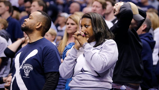 Xavier fans can barely watch as the game is tied during the second round of the NCAA Tournament at the Scottrade Center in St. Louis Sunday, March 20, 2016. Xavier lost 66-63.