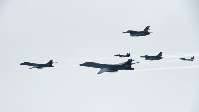 In this photo provided by South Korea Defense Ministry, U.S. Air Force B-1B Lancer bombers, left and second from left, fly with South Korean and U.S. fighter jets over the Korean Peninsula, South Korea Saturday, July 8, 2017. Two U.S. bombers flew to the Korean Peninsula to join fighter jets from South Korea and Japan for a practice bombing run as part of a training mission in response to North Korea's ballistic missile and nuclear programs, officials said Friday.
