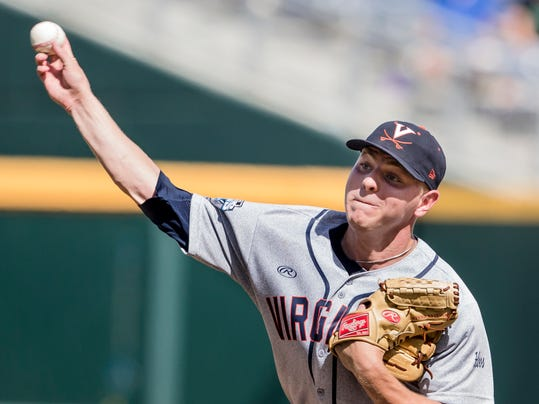 Virginia pitcher Artie Lewicki delivers against against Mississippi in the eighth inning of an NCAA College World Series baseball game in Omaha, Neb., Saturday, June 21, 2014. (AP Photo/Nati Harnik)