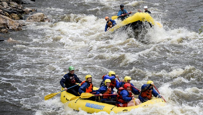 Rafters from A Wanderlust Adventure head down the Poudre River, Friday, May 15, 2015.