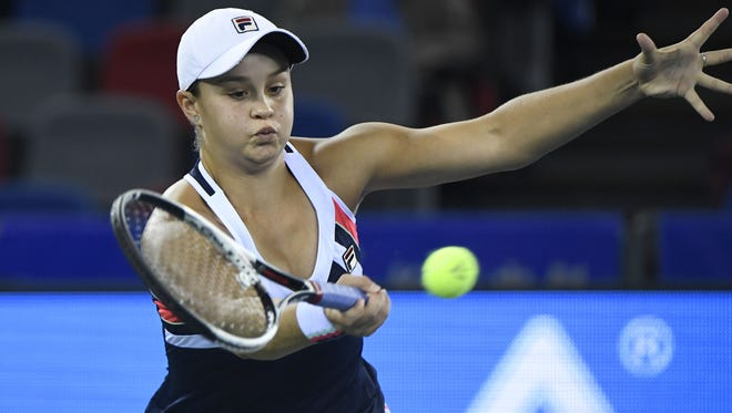 Ashleigh Barty of Australia return to Jelena Ostapenko of Latvia during their semifinals match at the Wuhan Open.