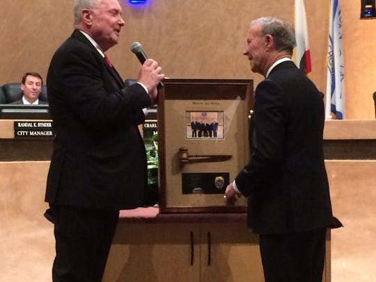 Newly appointed Mayor Charles Townsend presents outgoing