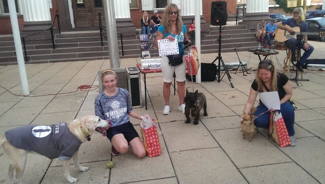 """Fido's First Friday winners, left to right: Ida, winner of """"Best Trick"""" with owner Kayla Mills of Chambersburg; Skeeter, """"Face Only a Mother Could Love"""" with owner Ruth Douglas of Chambersburg; """"Cutest Dog"""" Buddi, with owner Pamela, from Spokane, Washington."""