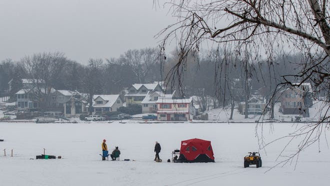 """Ice fishermen set up camp on Okauchee Lake during a 2016 fisheree. Department of Natural Resources conservation warden supervisor Rick Reed cautions that """"there is no such thing as safe ice."""""""