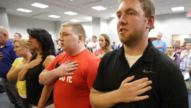 Andrew Maltbey, right, and his brother Nicholas attend an Appleton Common Council meeting in 2016.