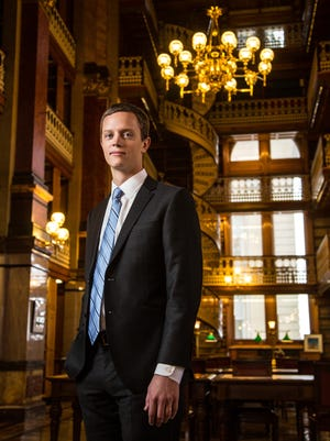 Assistant Iowa Attorney General Rob Sand stands for a portrait at the Law Library in the state capitol Monday, Dec. 7, 2015.