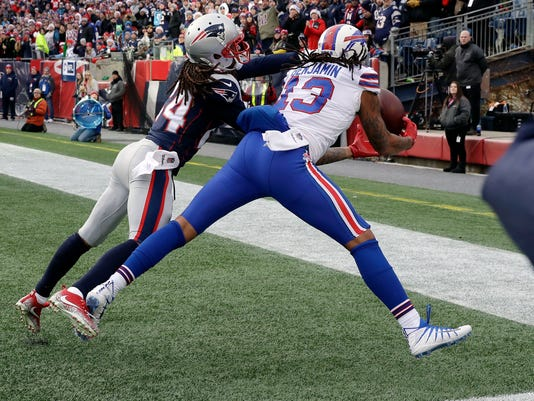 Buffalo Bills wide receiver Kelvin Benjamin (13) can't make a catch in the end zone in front of New England Patriots cornerback Stephon Gilmore, left, during the first half of an NFL football game, Sunday, Dec. 24, 2017, in Foxborough, Mass. (AP Photo/Charles Krupa)