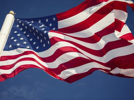 American flag over blue sky