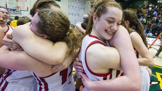 CVU's Sadie Otley, right, and her teammates celebrate the Redhawks' victory over BFA in the Division I high school girls basketball state championship in Burlington on Tuesday.