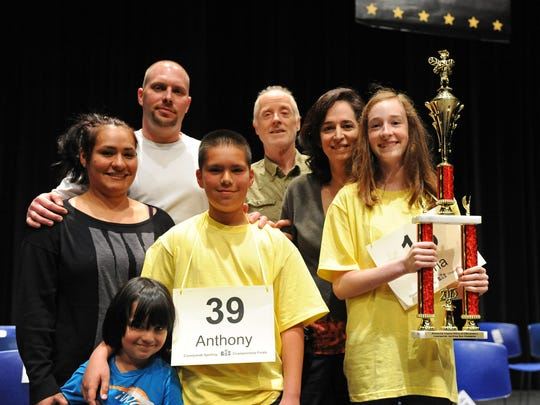 From right, the top two finishers at the Countywide Spelling Bee on Sunday: winner Nina Harmer, from All Saint's Day School in Carmel Valley, and her parents Ruth Rubin and Steve Harmer, with second-place finisher Anthony Santa Ana III, from Laurel Wood Elementary School in Salinas, with his parents Maria, Anthony Jr. and brother Nicholas.