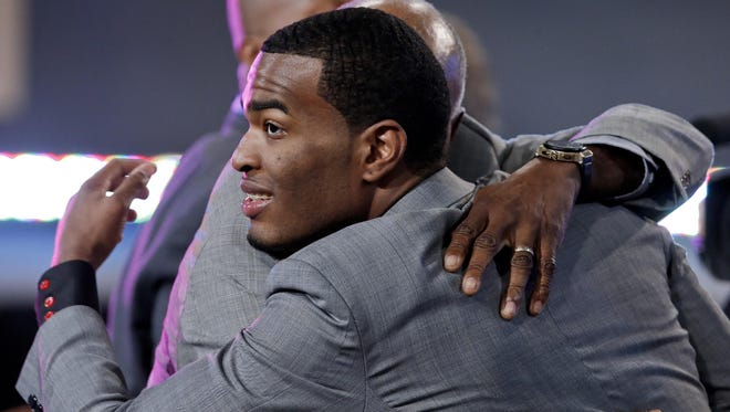 North Carolina State's T.J. Warren, right, is congratulated after being selected 14th overall by the Phoenix Suns during the 2014 NBA draft, Thursday, June 26, 2014, in New York.