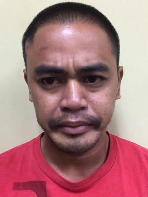 Domingo Sylvester Chargualaf Mendiola, 28, was charged with second-degree robbery and conspiracy to commit second-degree robbery.
