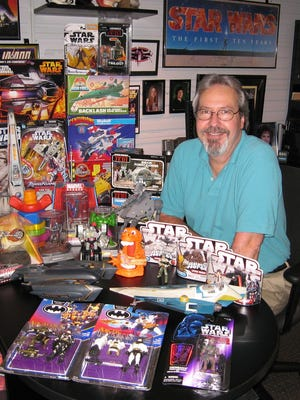 Mark Boudreaux, with some of the many Star Wars toys he has created for Hasbro.
