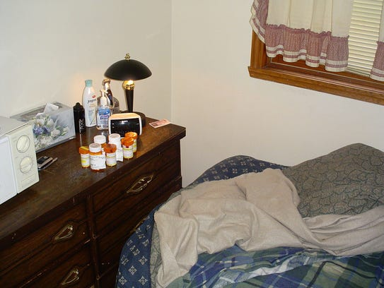 Police found several empty pill bottles on the dresser