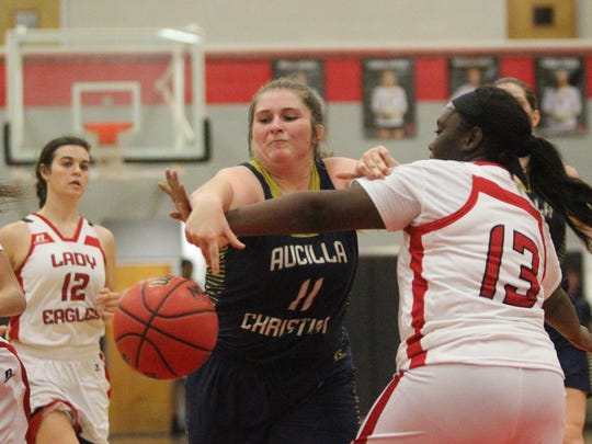 Ashlyn Rogers tries to grab a rebound as Aucilla Christian beat NFC 47-44 during a 2017-18 game.