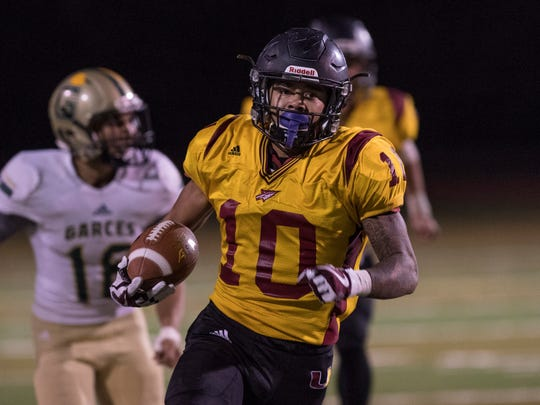 Tulare Union's Kazmeir Allen runs for a record-breaking
