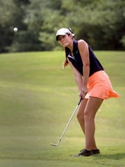 Oakland's Jessie Eaton chips her ball onto the green