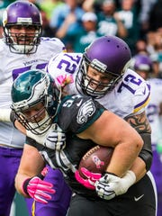 Philadelphia Eagles defensive tackle Beau Allen (No. 94) is tackled by Minnesota Vikings right tackle Jake Long (No. 72) after an interception in the second quarter of the Eagles 21-10 win over the Vikings at Lincoln Financial Field in Philadelphia on Sunday afternoon.