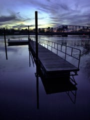 A dock floats freely in the waters of the Ouachita River that has over flowed the banks near the base of the levy along South Grand in Monroe in 2001.