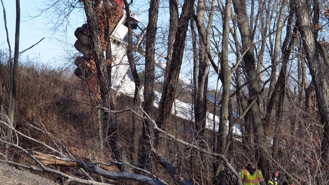 Emergency personnel are shown at the scene where a crane overtuned down an embankment along the Garden State Parkway, just north of Route 88 in Brick Township, Saturday morning, January 10, 2015. The operator was flown by MONOC-1 medevac to Jersey Shore University Medical Center for treatment. BRICK TOWNSHIP, NJ OVERTURNEDCRANE0110D STAFF PHOTO BY THOMAS P. COSTELLO ~