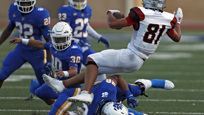 Frenship's Jake Gilbert (28) tackles Lubbock-Cooper's Ty Carter (81) during the game against Lubbock-Cooper, Friday, Sept. 13, 2019, at Peoples Bank Stadium in Wolfforth, Texas.