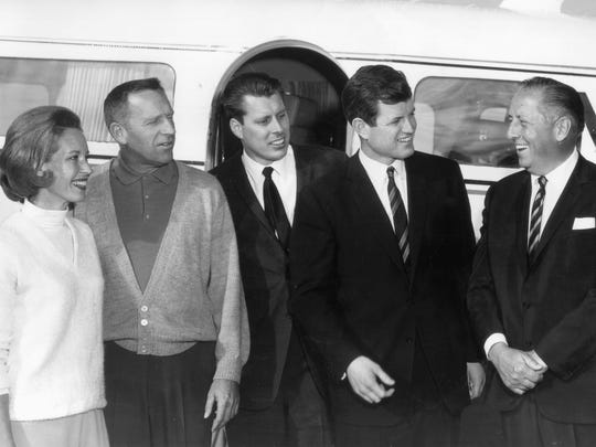 Senator Edward Kennedy is greeted by Bermuda Dunes co-owners Ray Ryan, right, and Ernie Dunlevie, left, as the brother of the late President flew into Bermuda Dunes Airport (near Palm Springs, Calif.) to campaign for John Tunney, third from left, son of former heavyweight champion Gene Tunney on June 30, 1964.