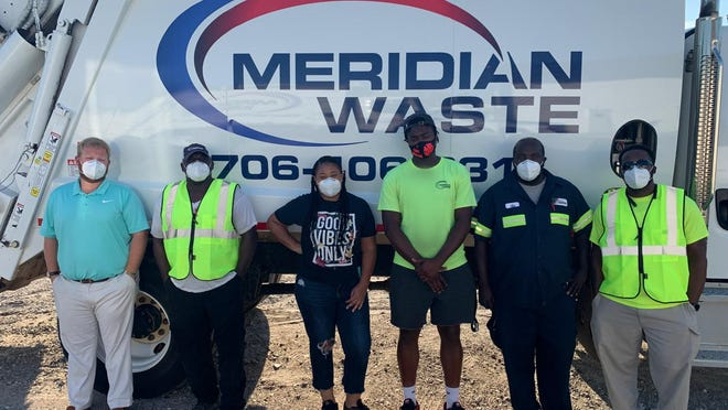 Meridian Waste Augusta staff pose with a company truck, from left, erek Waddle, general manager; Frankie Dye, residential driver; Bianca Bell, disptacher; Marquez Winfrey, residential helper, Tim McNair, residential driver; and Troy Winfrey, site manager.