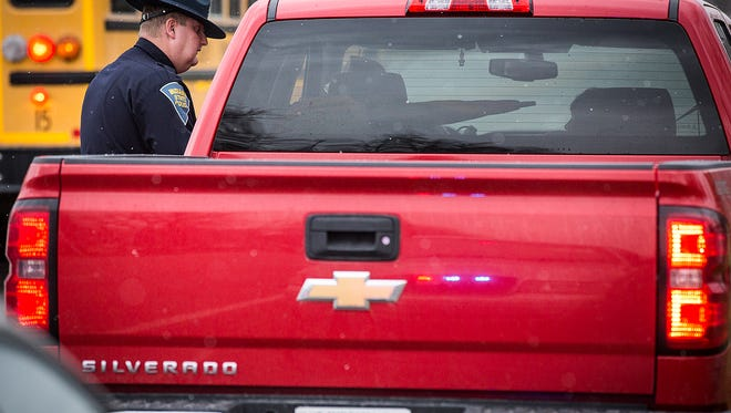 ISP trooper Coley McCutcheon pulls over the driver of a red pickup who failed to observe the bus stop arm law on Ind. 32.