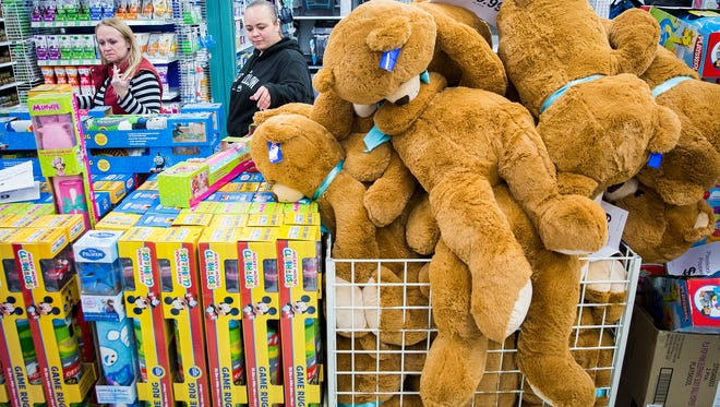 Black Friday shoppers make their way through Toys R Us after the store's 5 p.m. opening Thursday.