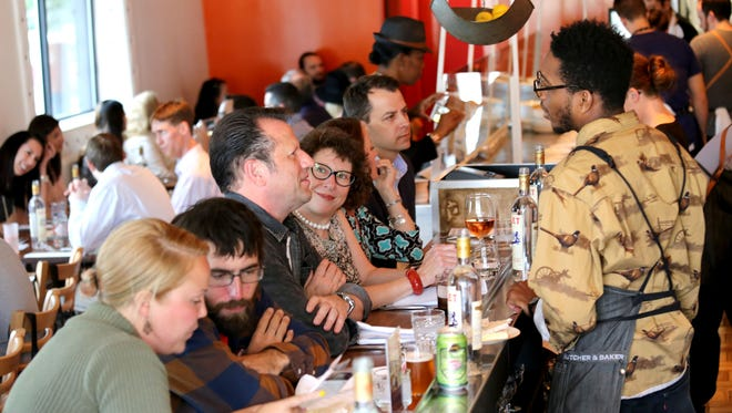 Guests at James Rigato's Mabel Gray restaurant in Hazel Park in June 2016.